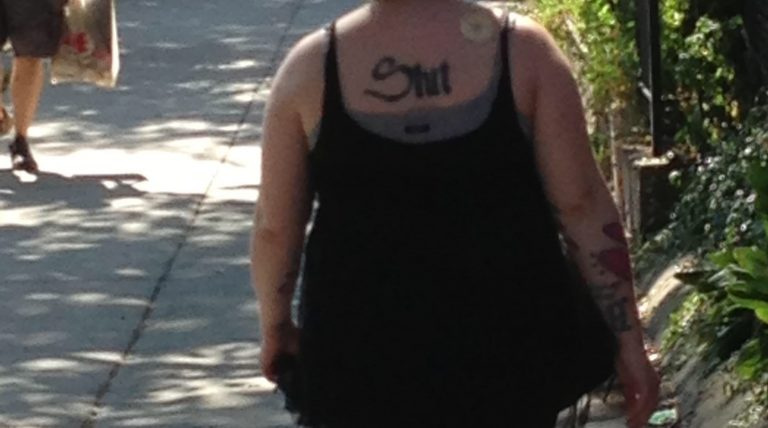 What does her tattoo say?