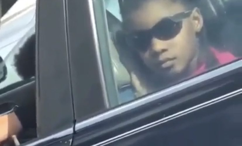 girl caught kissing backseat of car