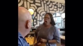 Angry woman coughs on man in restaurant