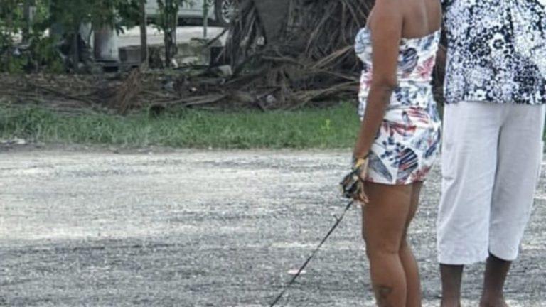 Woman puts crab on leash