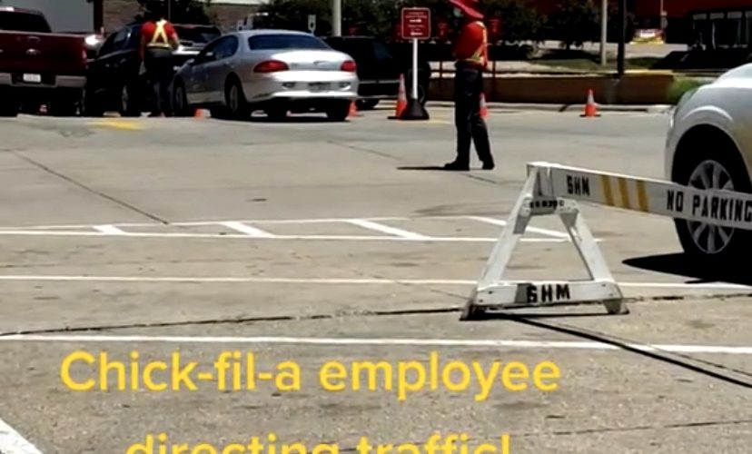 Chick-Fil-A employee directs traffic