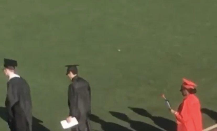 Girl wears heels during graduation
