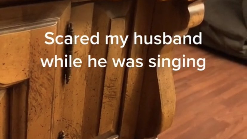Husband gets caught off guard while singing
