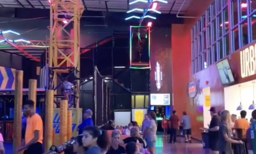 Man flies down indoor zipline