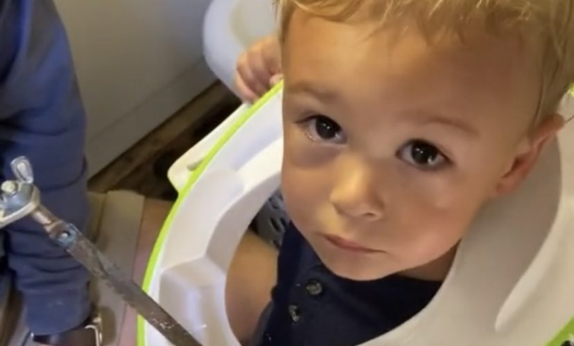 Toddler gets toilet seat stuck around his neck