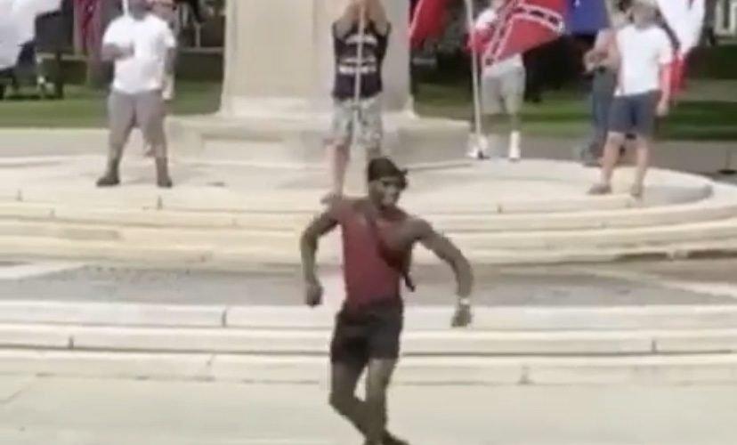 Man dances in front of protestors