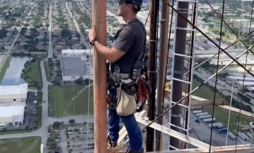 A tower climber shows how they go while working