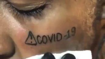 Man gets a COVID-19 tattoo