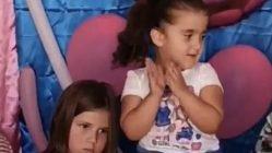 little girl pulls hair at birthday