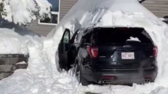 Car trapped under pile of snow