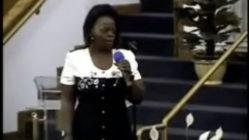 Woman sings gospel song in church
