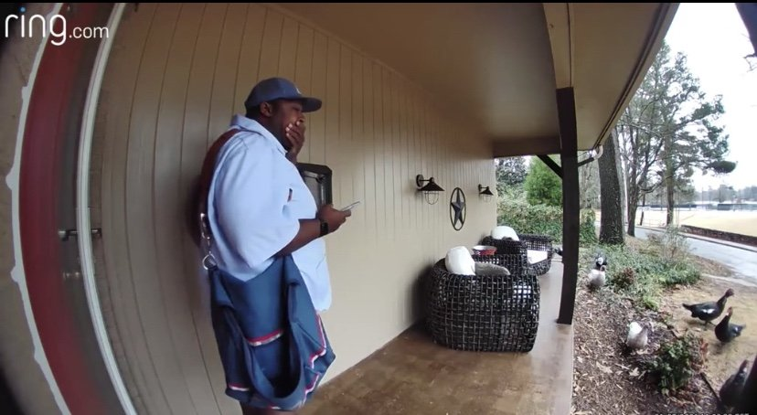 USPS delivery man trapped on porch