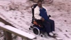 Uncle Tee flies in his electric wheelchair