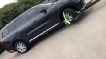 Woman takes her car back from repo man