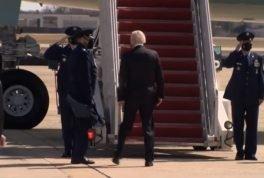 President Biden trips up steps