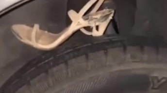Woman heel punctures tire