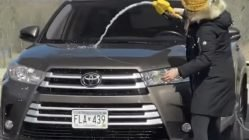 Woman washes car with gasoline