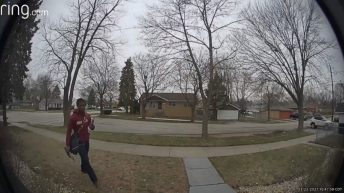 Scared mailman takes off running on delivery