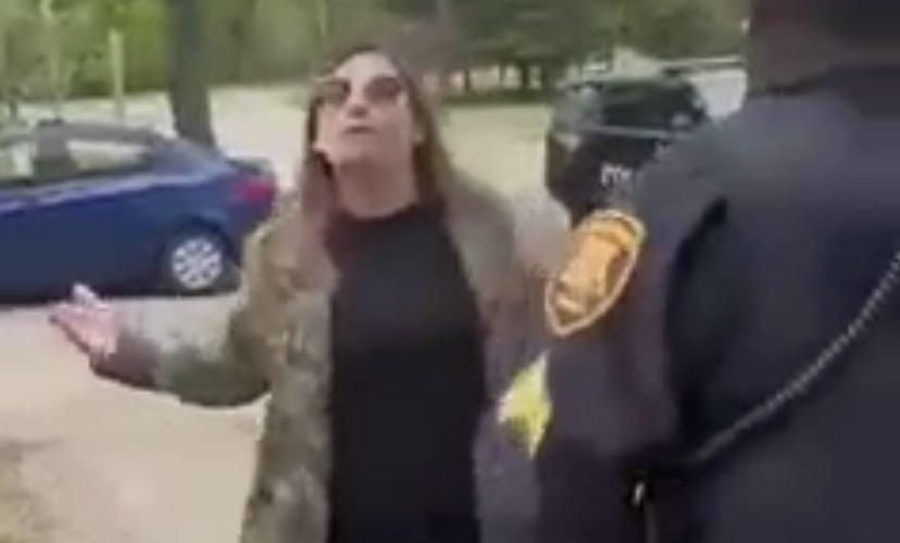 woman moons a woman in public