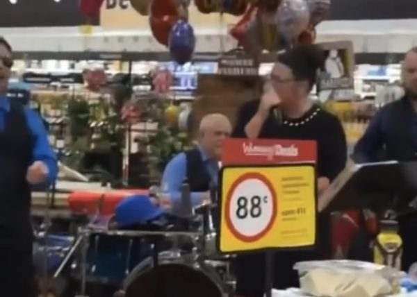 Local band plays wobble for grocery store customers