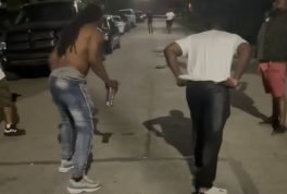 Men try to race each other in the street